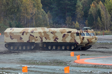 NIZHNY TAGIL, RUSSIA - SEP 25, 2013: The international exhibition of armament, military equipment and ammunition RUSSIA ARMS EXPO (RAE-2013). Two-tier tracked all-terrain amphibian vehicle