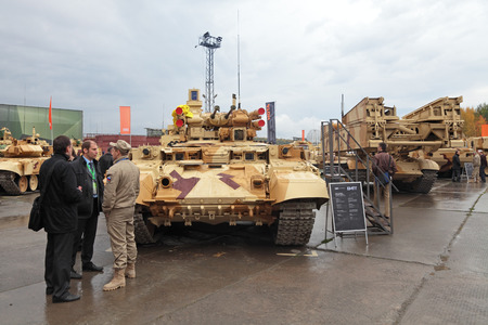 NIZHNY TAGIL, RUSSIA - SEP 26, 2013: The international exhibition of armament, military equipment and ammunition RUSSIA ARMS EXPO (RAE-2013). Customers visiting BMPT Ramka - Russian Tank Support Fighting Vehicle Terminator