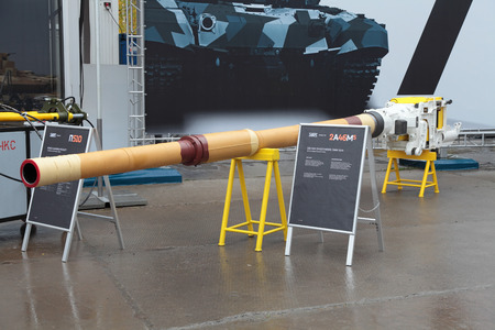NIZHNY TAGIL, RUSSIA - SEP 26, 2013: The international exhibition of armament, military equipment and ammunition RUSSIA ARMS EXPO (RAE-2013). 125-mm smoothbore tank gun production Uralvagonzavod (UVZ)