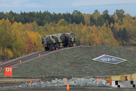 NIZHNY TAGIL, RUSSIA - SEP 26, 2013: The international exhibition of armament, military equipment and ammunition RUSSIA ARMS EXPO (RAE-2013). The 6x6 heavy-duty off-road truck specially designed for army service