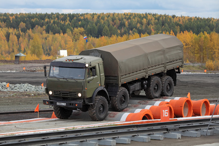 NIZHNY TAGIL, RUSSIA - SEP 26, 2013: The international exhibition of armament, military equipment and ammunition RUSSIA ARMS EXPO (RAE-2013). KAMAZ 6350 - unified military multipurpose 8x8 all-wheel drive truck on the obstacle course