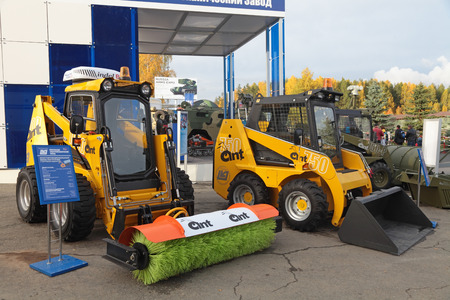 NIZHNY TAGIL, RUSSIA - SEP 26, 2013: The international exhibition of armament, military equipment and ammunition RUSSIA ARMS EXPO (RAE-2013). Multifunctional mini tractors