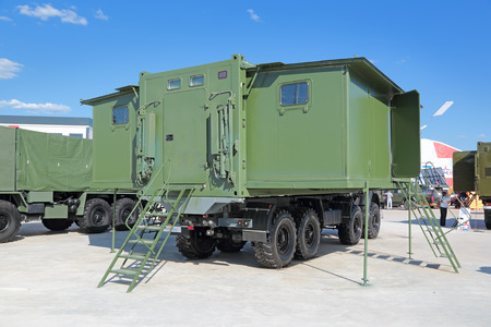 KUBINKA, MOSCOW OBLAST, RUSSIA - JUN 18, 2015: International military-technical forum ARMY-2015 in military-Patriotic park. Trailer kitchen-dining room in transfermium the container of variable size