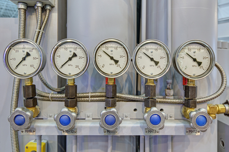 Five pressure gauges with liquid filling, close-up