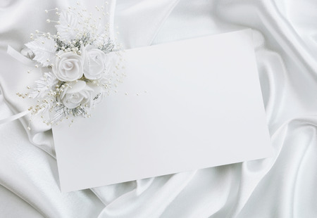 The wedding invitation with a bouquet of the bride on a white background