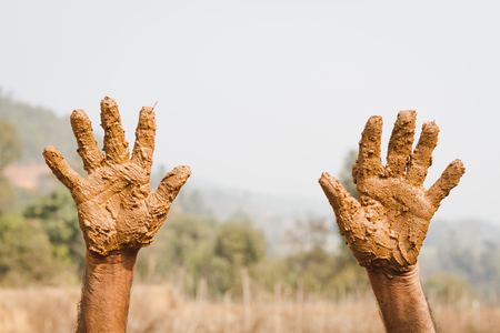 Unidentified Worker showing his muddy hands, Dirty Hands.