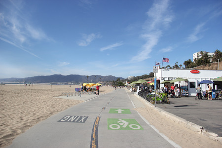 Santa Monica, California, USA - November 16, 2014: Beautiful scenery of Santa Monica Beach with bicycle lane for cyclists.
