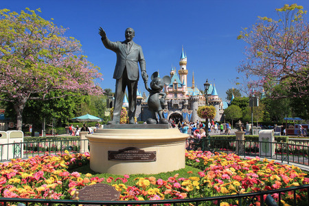 Statue of Walt Disney and Mickey Mouse, known as Disney Partnes Statue, is welcoming all guests right in front of Sleeping Beauty Castle at Disneyland.