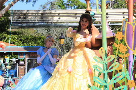 Anaheim, California, USA - May 30, 2014: Cinderella and Princess Belle in Disney Parade at Disneyland