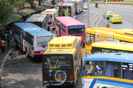 Bangkok Thailand  April 16 2015: Many Bangkok BMTA bus lines stop around the Victory Monument's traffic circle which is one of Bangkok's major traffic intersections.