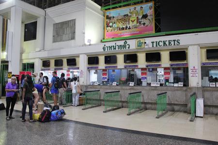 Bangkok, Thailand - May 8, 2015: Passengers are buying train tickets at ticket booths of Bangkok Railway Station.
