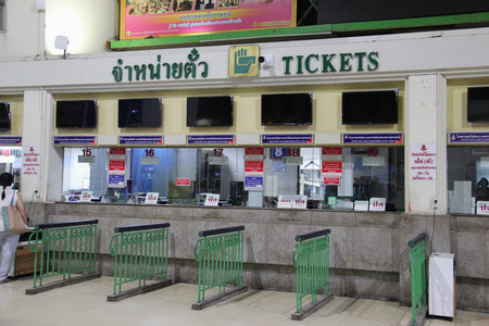 Bangkok, Thailand - May 8, 2015: Train ticket booths at Bangkok Railway Station, which serves over 130 trains and approximately 60,000 passengers each day.
