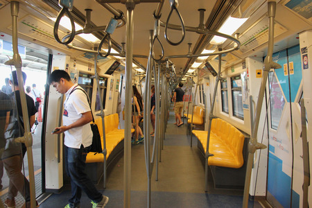 Bangkok, Thailand - May 9, 2015: Passengers are getting off Skytrain at its terminal. The Bangkok Mass Transit System, known as BTS system, consists of 34 stations along two lines.
