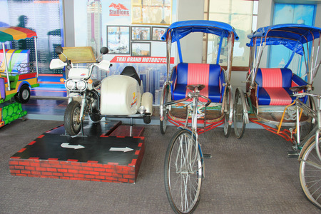 Bangkok, Thailand - April 28, 2015: Thai tricycles and Thai brand motorcycle are displayed on the observatory floor of Baiyoke Tower 2 in Bangkok, Thailand.