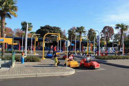 Carlsbad, California, USA - December 27, 2014: Promoting safe driving and skills, Volvo Driving School at Legoland California give children driving experience with Lego cars on a closed circuit featuring multiple intersections, two way traffic, traffic si