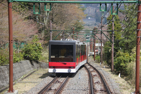 Hakone, Japan - April 9, 2015: Hakone Tozan Cable Car is a funicular railway racing effortlessly up the steep slope in Hakone.