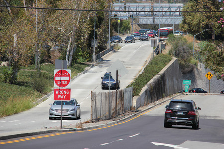 Los Angeles, California, USA - August 14, 2015: Cars driving down off ramp from a freeway in Los Angeles.