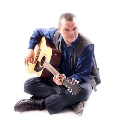 Photo pour Mature musician plays acoustic guitar emotional studio portrait on white background. - image libre de droit