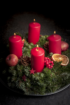 Studio shot of a nice advent wreath with decoration and four ...