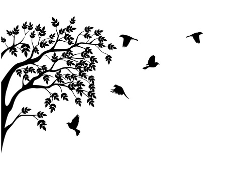 Tree silhouette with bird flying