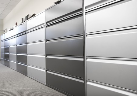 Long row of large filing cabinets in an office or hospital