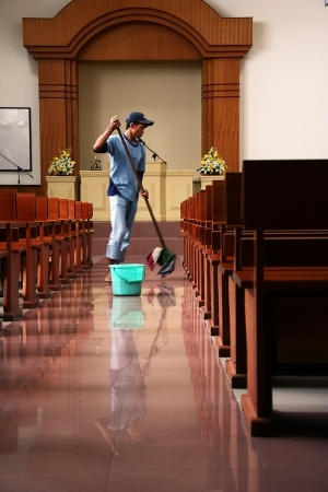 A Janitor mopping the floors of a church in Kalimantan (Borneo), Indonesia.