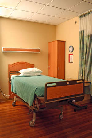 clean empty bed in a hospital