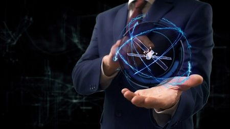 Photo for Businessman shows concept hologram 3d Satellite on his hand. Man in business suit with future technology screen and modern cosmic background - Royalty Free Image