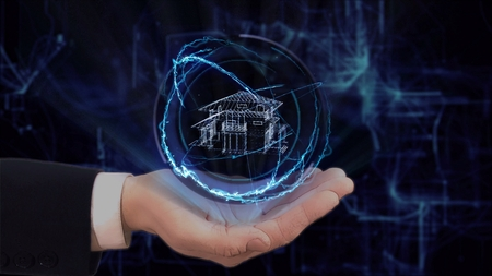 Photo pour Painted hand shows concept hologram house on his hand. Drawn man in business suit with future technology screen and modern cosmic background - image libre de droit