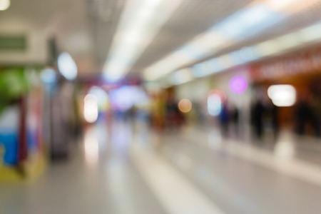 People are shopping in a supermarket. Blur and defocus image as a background and postcard designs.