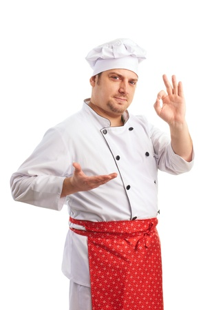 smiling chef in uniform shows fingers