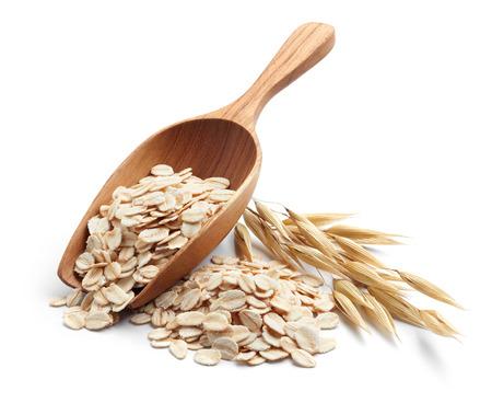 Photo pour scoop and pile of oatmeal with its plant - image libre de droit