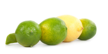Several limes and lemons lined scarcely on a white background