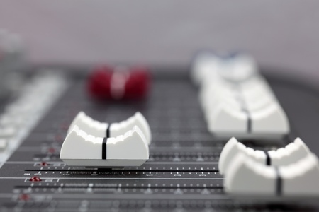 Closeup of audio mixing console. Shallow depth of field