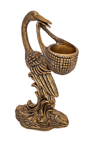 Bronze candlestick in the form of a stork holding a cradle isolated on white background