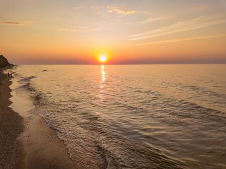 Photo pour Aerial panoramic view of sunrise over ssea. Nothing but sky, clouds and water. Beautiful serene scene - image libre de droit