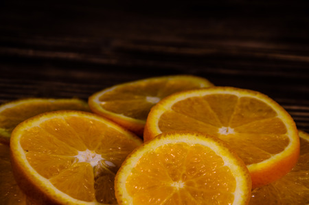 Slices of the orange on wooden table