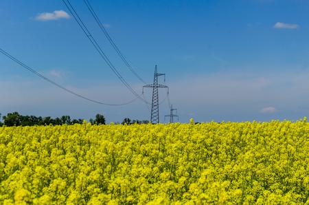 High voltage power line against blue sky