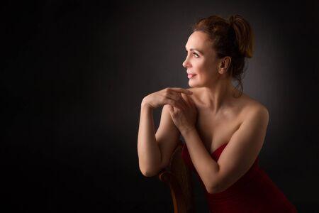 Photo pour portrait of a sensual fifty year old woman on grey studio background - image libre de droit
