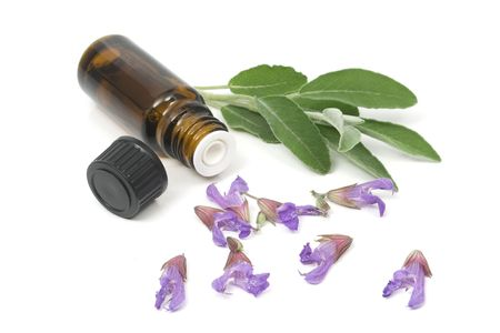 Sage flowers and essential oil bottle used for aromatherapy