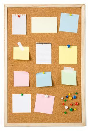 Blank sticky notess pinned on cork notice board