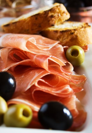 Prosciutto di Parma with olives and toasted bread