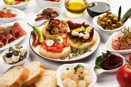 Table full of mediterranean appetizers, tapas or antipasto