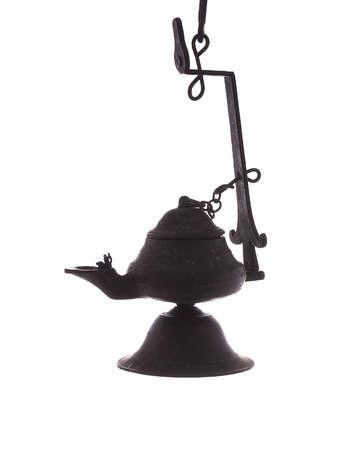 old lamp from copper is isolated on a white background