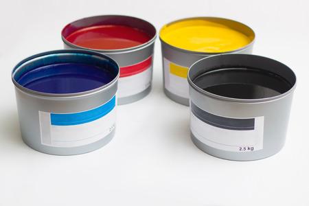 Foto de Cmyk color paints in cans over white - Imagen libre de derechos