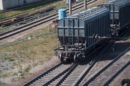 Photo pour Rail freight cars at the railway station - image libre de droit