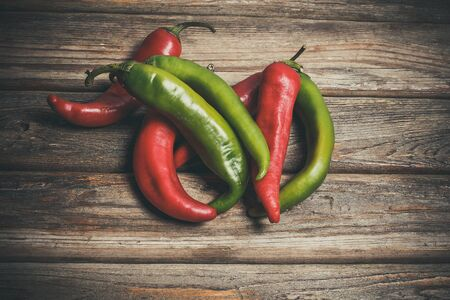 Foto für Hot peppers for spicy dishes on a wooden vintage table - Lizenzfreies Bild