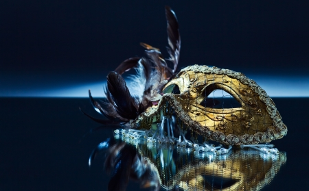 Photo for The Venetian mask with feather on a mirror table - Royalty Free Image