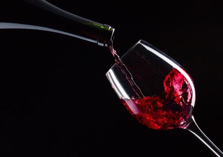 Foto für bottle and glass with red wine on  black  - Lizenzfreies Bild