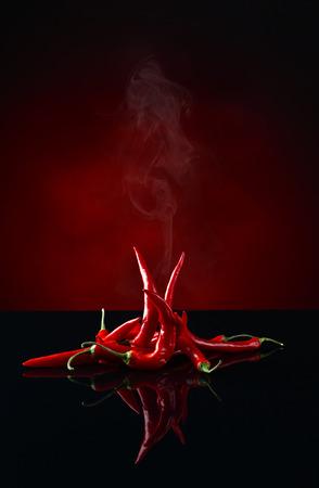 Foto für beam of red chilli pepper on black background - Lizenzfreies Bild